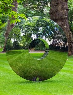 The mirrored doughnut lawn sculpture out front would make for a great portal. Or maybe it is one already.
