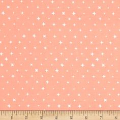 From Cloud 9 Fabrics, this certified 100% organic cotton print fabric meets the GOTS certification; only low impact, organic dyes were used in this product. Perfect for quilting, apparel, and home decor accents. Colors include peachy coral and white.