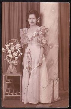 A young Filipino lady wearing a national clothing/ dress called 'terno'.