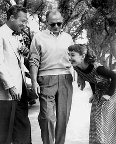 William Holden, and always-laughing, Audrey Hepburn. Other man unidentified.