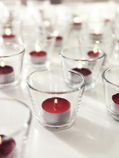A sea of lights glimmer in clear GALEJ tea-light holders.