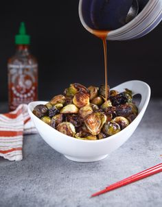 Roasted Brussels Sprouts with Honey, Sriracha, and Lime--great sauce!  Used only 2 tbsp of honey and used as a dipping sauce instead to retain the crunchiness!