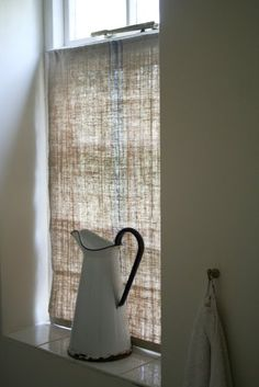Half curtain for privacy (whether it be for the bathroom or a window directly facing a house next door).