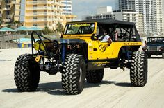 Big yellow rear steer Jeep. Designed and constructed by Jeepetos in St. Petersburg, FL.