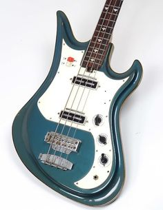 Ultra Rare and Top of the Line Spectrum Bass. This is the bass equivalent to the Spectrum V guitar that was part of Teisco's Space Age inspired designs. Blue Metallic Finish, Dual Pickups, an. Guitare Fender Stratocaster, Chet Atkins, Les Paul Custom, Metallic Blue, Spectrum, Bass, Design Inspiration, Toot, Space Age