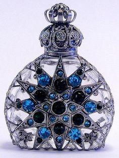 Checa botella antigua de perfume