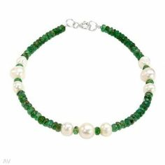 Sterling Silver Pearl and 14.4 CTW Emerald Ladies Bracelet. Length 7.5 in. Total Item weight 6.1 g. VividGemz. $37.00