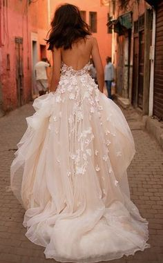 No one will be able to look away while your wearing this stunning, flowing wedding gown. Complete with layers of tulle and cascading lace flowers along the back make this dress ideal for a vintage chic or modern twist wedding. See more wedding ideas here: https://www.modwedding.com/galleries/wedding-dresses/wedding-dresses-7-04232017-km/?gallery=175426149&index=&source=&ad=false&tag=false