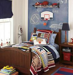 love the sports theme and the basketball hoop above the bed is pretty awesome, not sure id be able to get Ry out of our son's room