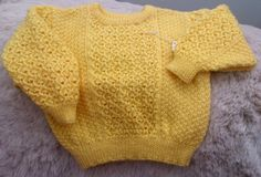 """A sunshine colour for a summer day. In machine washable 4 ply acrylic this 22"""" / 56cm chest cardigan with a pretty centre lace panel on front and sleeve is available for £12.75 delivered to the UK mainland. Message me for any questions or to order."""