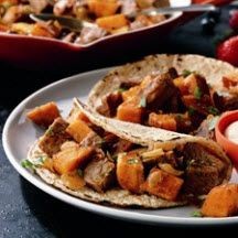 Beefy Sweet Potato Hash - The perfect way to give leftover steak or roast new life, this hash is made with sweet potatoes and taco seasoning.