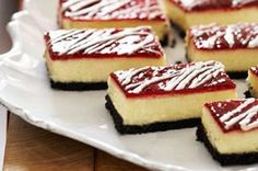 Raise the bar on your tree decorating night with White Chocolate-Raspberry Cheesecake Bars trimmed with an OREO Cookie crust.