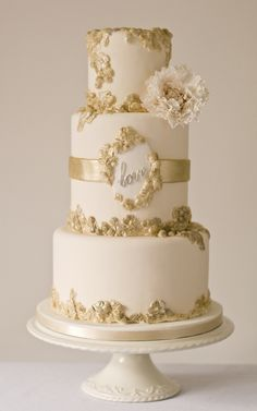 Gold and rose gold bas relief cake with love and deep tier