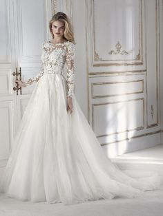 Long sleeve gall gown with lace sleeves from La Sposa