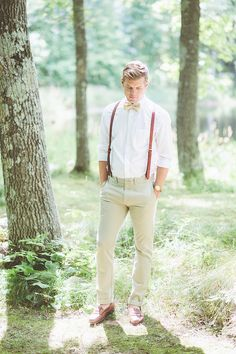 His: Colored suspenders. Hers: Coordinating ribbon on bouquet. Source: Photo by Paper Antler via Style Me Pretty