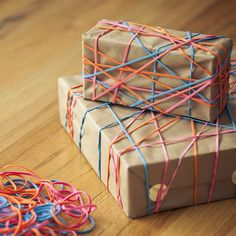 You might consider for your gift wrapping adventures    Just beware the people that will use these rubber bands as ammunition....