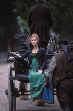 Green gown - couldn't find pics showing sleeves; Black jacket with blue lining; Vanity Fair (the movie)