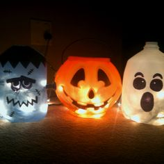I made these with permanent market & a white milk jug for the ghost, a blue water jug for frankenstein & a trick or treating bucket from Walmart for .50 cents, add Christmas lights or glow sticks & u have perfect cheap Halloween decor for kids!!!