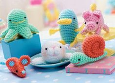 Cute Amigurumi creatures: a piggy, octopus, snail, baby seal and more