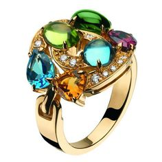 Bulgari    Concentrica Ring in 18kt yellow gold with one peridot, one green tourmaline, two blue topazes, one citrine, 1one rodolite and pavé diamonds. Available at Bulgari Bal Harbour.