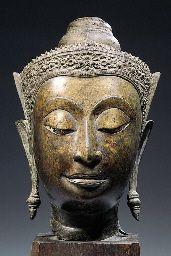 a thai, ayutthaya style, bronze head of buddha sakyamuni  17th century  His face…