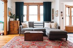 The sofa is second hand, and the throw pillows are from Detroit Artifactry and Wood + Cloth.