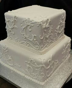 White wedding cake with filigree designs made by Lakeisha Hill / Keck with Sweet Tooth Mother and Daughter Cakes.