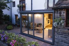 night time shot of glass lean to at back of house Glass Extension, Roof Extension, Extension Plans, Garden Room Extensions, House Extensions, Kitchen Extensions, Porches, Lean To Conservatory, Kim House