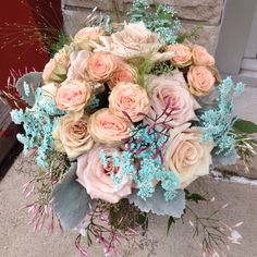 Vintage style bridal bouquet & color palette of ivory, blush, mocha pink, antique pink with accents of Tiffany blue. Roses, spray roses, Queen Anne's lace, dusty miller, jasmine vine & explosion grass.