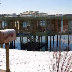 """2005 - """"The Lake House"""" was constructed at Maple Lake near Chicago expressly for the movie with Sandra Bullock and Keanu Reaves. It was destroyed after filming. Architect Nathan Crowley collaborated with engineers McDonough Keanu Reeves, Sandra Bullock, Modern Lake House, Lake House Plans, Seen, Waterfront Homes, Celebrity Houses, Lake Life, Glass House"""