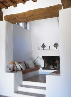 seating nook beside the fireplace | interior design + decorating ideas