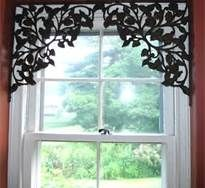 These are beautiful shelf brackets, repurposed to frame a window!  Great easy window treatments.