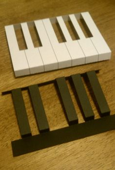 Andrew is a pianist and piano teacher, so I was looking on Pinterest for card designs involving pianos. I saw a design of a pop-up card of a piano keyboard and decided I should give something like …