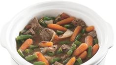This all-in-one beef stew, made fast with baby-cut carrots, canned tomatoes, and frozen green beans, simmers all day to meld flavors perfectly.
