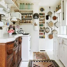 A Laurel Canyon Cottage Home with a Hollywood Past : Architectural Digest *Spice rack with mason jars on top.*