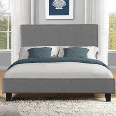 This stunning Colby upholstered platform bed by Zipcode™ Design will transform your bedroom. It ships in one carton with the frame, legs and wooden slats conveniently located in the zippered compartment in the back of the headboard for easy assembly. This contemporary upholstered (enter size) platform bed features a square stitched headboard and low profile footboard style frame, with wood slats and exposed feet for support. The dark gray upholstery looks luxurious and this platform bed…