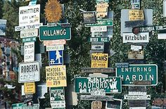 Watson Lake, Yukon: Sign Post Forest ~ Started in 1942 by a homesick GI during construction of a highway needed for war time transport.