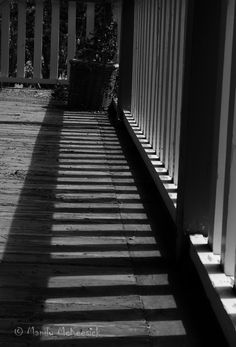 L2M1AP2 Time of Day. Middle of day shadows on veranda. I experimented with AE-L to give a darker exposure and then changed to B & W in LR to accentuate the contrasting lines. Nikon D5100, P Mode, no flash, f/8, 1/250, 48mm, ISO 100, handheld