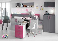 Habitación infantil con cama alta sobre armarios block con escritorio