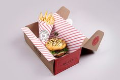 """Fantastic identity and packaging set created by Mexican studio Firmalt for a local burger bistro. """"Bouch Burger Bistro was created with the intent of perfecting… Burger Packaging, Cool Packaging, Brand Packaging, Design Packaging, Paper Packaging, Packaging Ideas, Local Burger, Burger Box, Burger Stand"""
