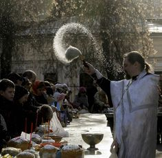 A Russian Orthodox priest blesses Easter cakes and colored eggs during an Orthodox Easter ceremony