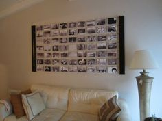 I like this idea. Take 2 IKEA wall shelves and turn on their side. String wire across and secure, then clip photos onto the wire. In this case the owner clipped travel photos of places she'd like to go, which created a striking collage. All items for this project from IKEA. Click link for detail pictures.