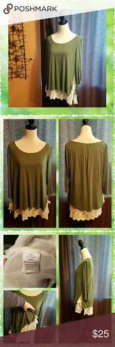 Olive green top with lace underlay Beautiful, lightweight olive green top. With a cream color sheer lace camisole underneath. Ribbon ties on each hip. Length from shoulder to bottom of lace is approximately 29 inches. LC Lauren Conrad Tops
