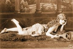Google Image Result for http://chuckman1920sarcadecardbeauties.files.wordpress.com/2012/04/x-studio-portrait-witzel-l-a-movie-star-mary-miles-lying-down-with-gypsy-like-outfit-and-lute-beautiful-image.jpg
