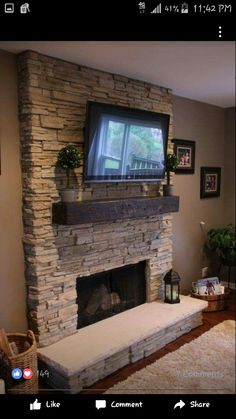 Stacked stone fireplace with reclaimed wood mantel. Gonna have to see if grandpa can help me make the fireplace look like this instead :) Stone Fireplace Designs, Stacked Stone Fireplaces, Fireplace Redo, Living Room With Fireplace, Fireplace Surrounds, Fireplace Ideas, Basement Fireplace, Simple Fireplace, Modern Fireplaces