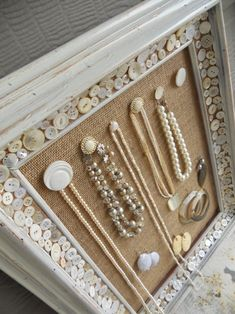 diy jewelry hanger - cork, burlap, buttons, and tacs. hot glue buttons on tacs and around the border for decoration
