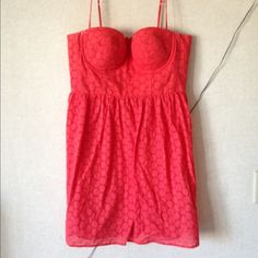 HP!!Spaghetti strap coral eyelet dress HOST PICK Spaghetti strap Coral eyelet dress with built in cups and underwire and a structured bodice. Worn once. Zips up the back. Moda International Dresses Mini