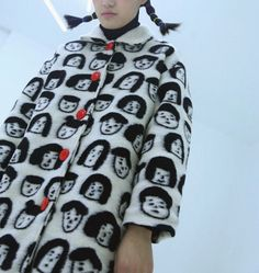 Once upon a time collection.  Unique black and white coat. The design is long coat with shape. The buttons are red. The portrait head part is wool knitting by hand, every piece could be slightly different. The coat has cotton layer inside, very warm. The collar part is lamb fur. Please only use dry wash.  Fabric: 60% wool+polyester (DRY WASH) Therere 2 sizes available, heres the measurement in cm: Shoulder/chest/length S 52/114/96 M 54/118/98  same fabric we also have other designs: short…