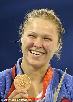 Ronda Rousey taking the bronze in the women's judo at the Beijing games in 2008. Happiness is being a champion. RondaRousey.net / #ArmbarNation