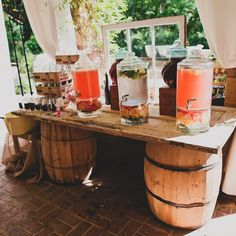 Probably do it a little different, but like the barrells/table/containers for drink station! #vintage